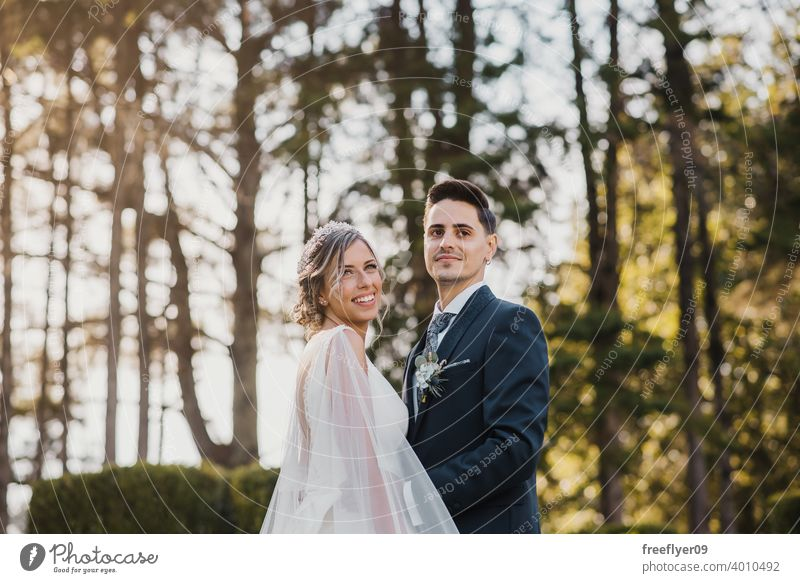 Portrait of a young couple on their wedding day marriage engagement bride people attractive copy space groom tree nature exterior sunlight summer 2 love romance