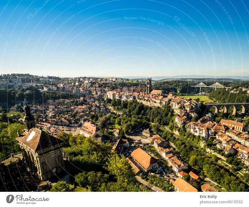 Landscape panoramic view of the city of Fribourg in Switzerland, with the Saint-Nicolas cathedral in the background Europe european Swiss landscape cityscape