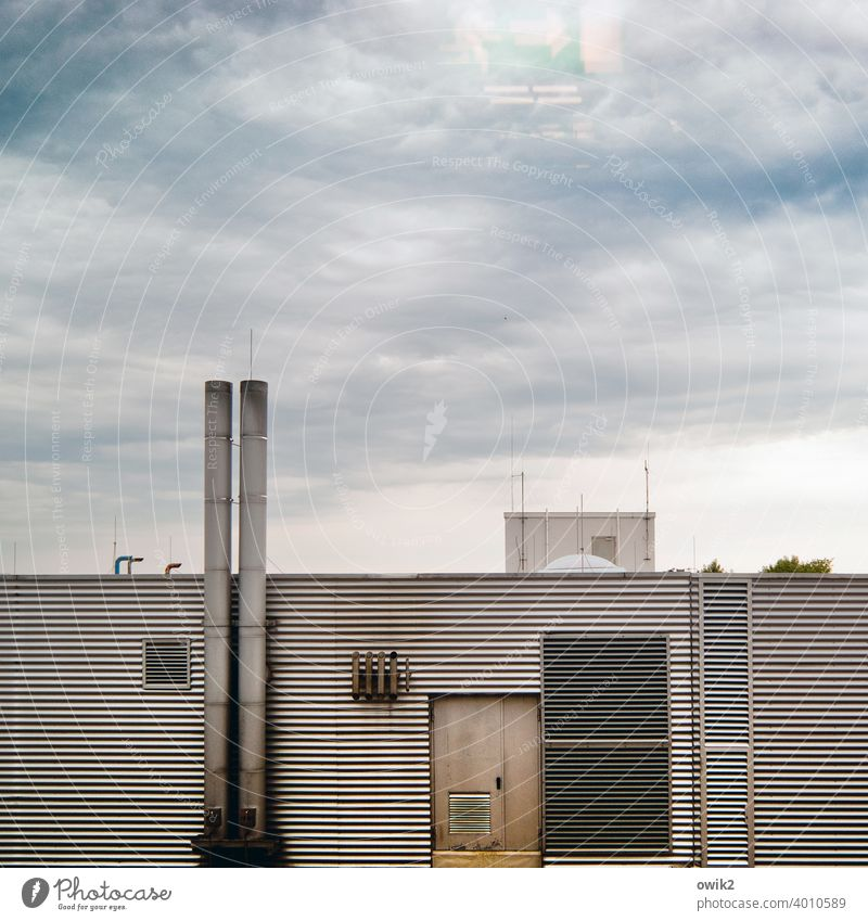 escape route Facade Boiler house Trigger Chimney door Corrugated sheet iron Metal Clouds lines Evening Parallel Wall (building) Detail Exterior shot Sky