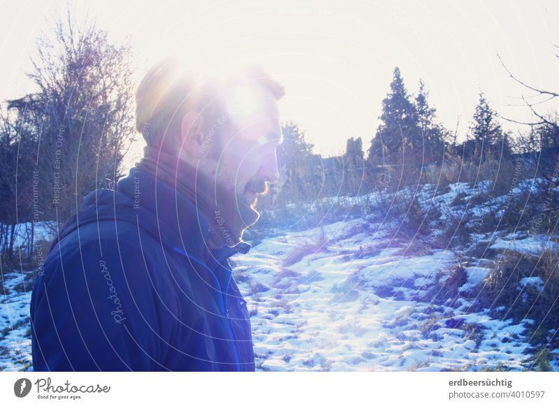 Man in cold winter landscape with sun rays cap Winter Cold Landscape profile picture Blue White Frost Sun Scarf mustache Light Ice chill Freeze Exterior shot