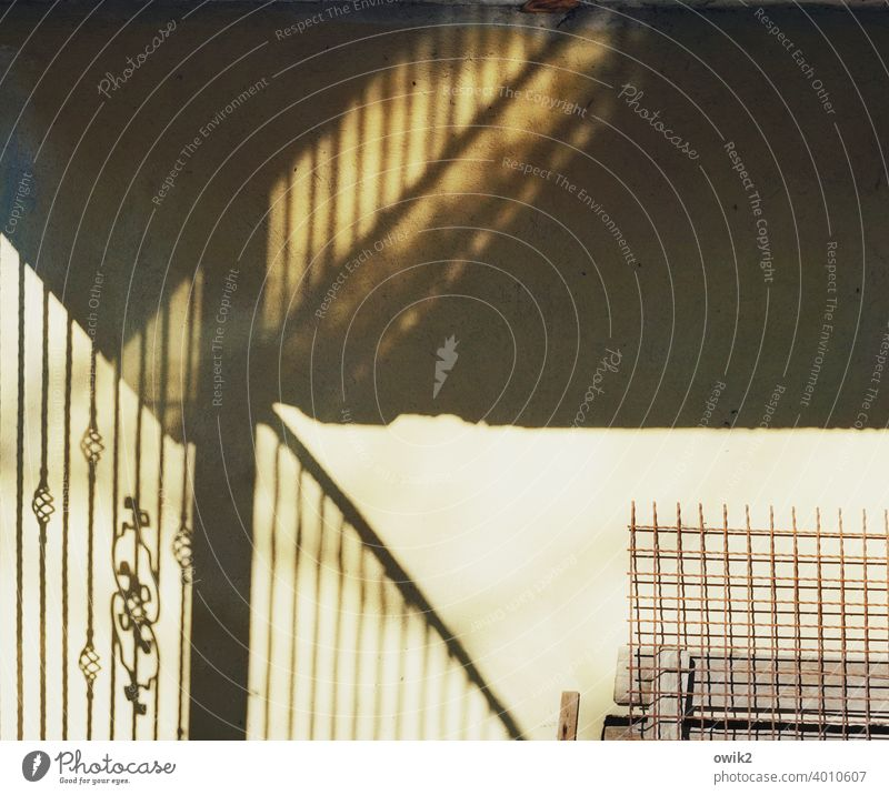 Reliable Wall (building) Fence Metal Concrete Ornament Deserted Wall (barrier) Corner Mysterious Light Sunlight Light (Natural Phenomenon) Contrast Esthetic