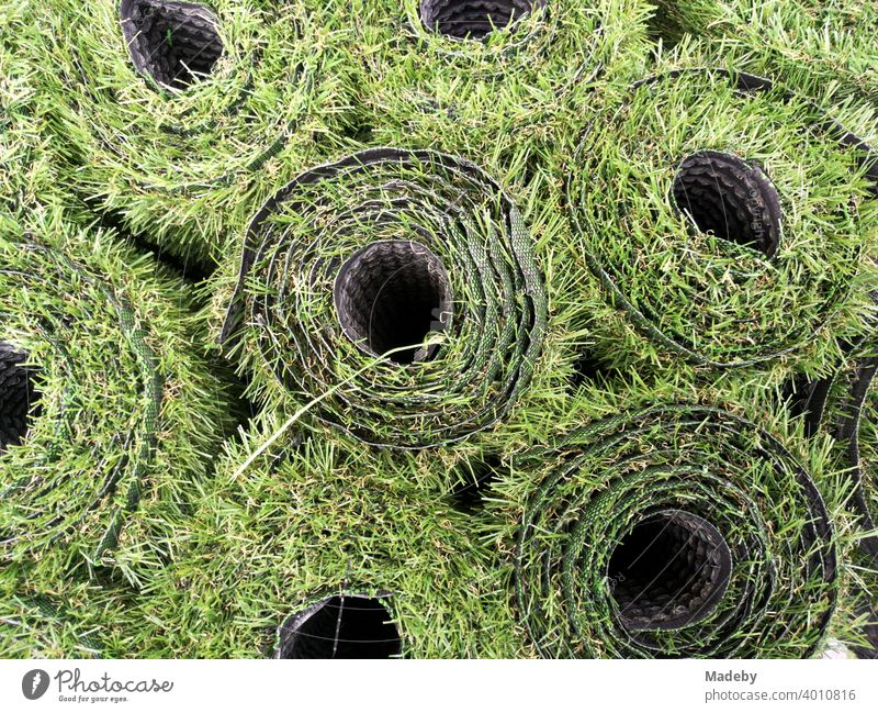 Green rolls of artificial grass for the balcony in front of a shop at Hackescher Markt in summer in the capital Berlin Lawn Artificial lawn Grass Round Coil