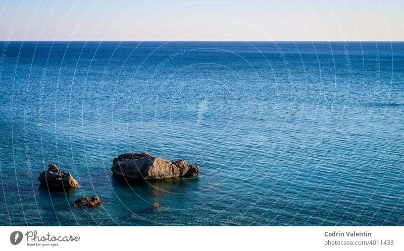 Rocks in the sea. Show of rocks. Calm blue sea azure bay beach boat coast composure ecoregion horizon lake landscape liquid natural landscape nature no person