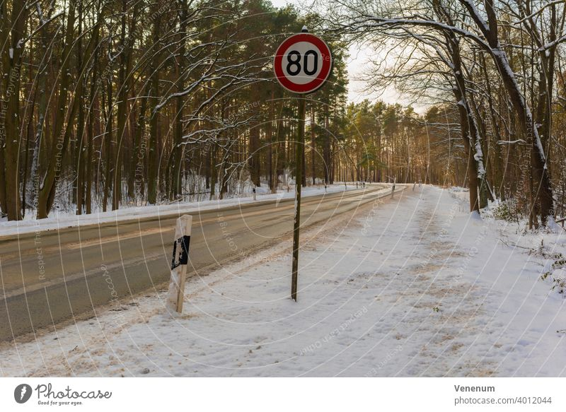 Germany , Land Brandenburg , February 10, 2021 , Gottower Chaussee K7222 between the town of Luckenwalde and the village of Gottow,Country road in winter with snow in the late afternoon