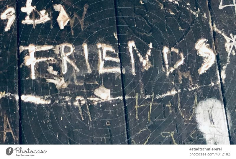 friends Friends Friendship Joy Human being Exterior shot Youth (Young adults) Together Scribbles Street art Daub Colour photo Characters Wall (building)