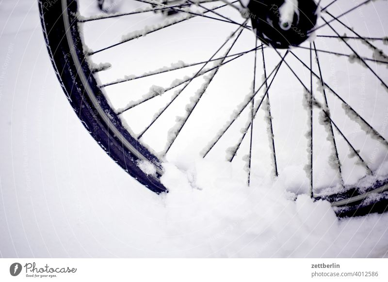 Front wheel in snow Snow Virgin snow Snowfall Winter winter holidays Wheel Bicycle Spokes Wheel rim winter tyres handicap smooth peril Dangerous