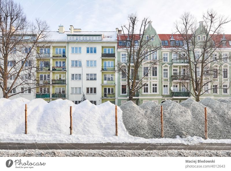 Road construction site in winter, Szczecin, Poland. land filler road street repair city snow building house residential Stettin townhouse industry