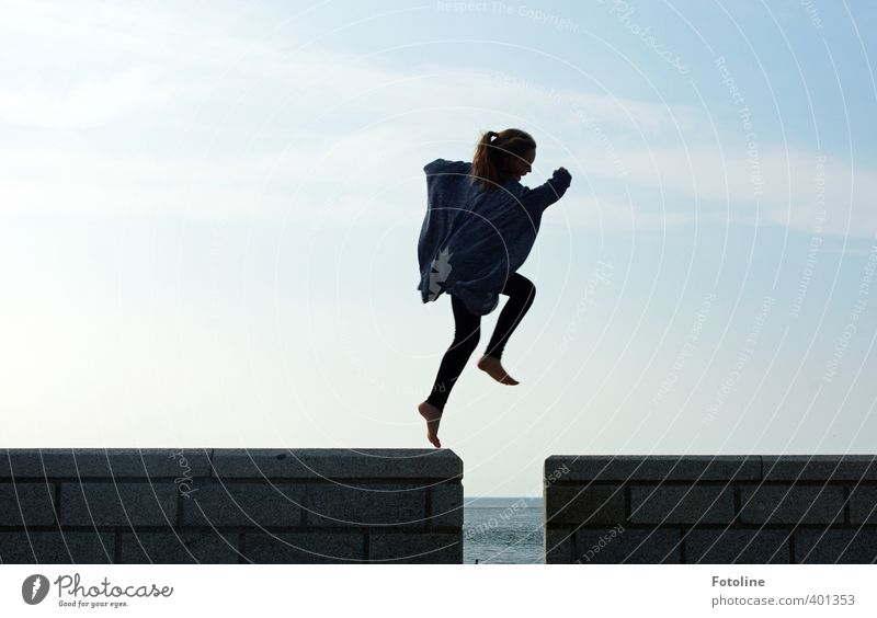 Human being Child Sky Girl Clouds Black Feminine Wall (barrier) Happy Head Jump Legs Feet Body Infancy Arm