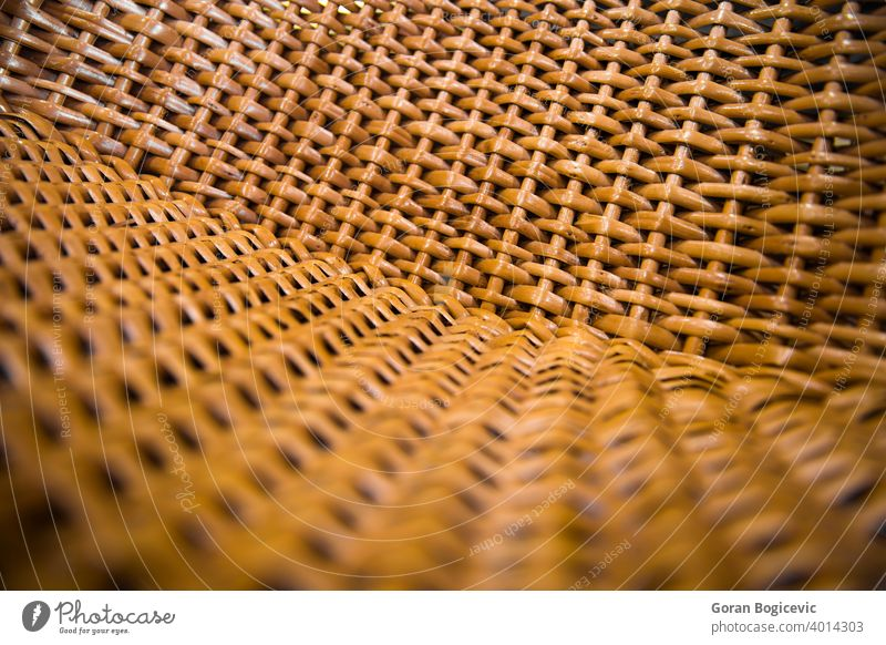 Closeup detail of the wicker chair pattern design material closeup textured mesh surface background rattan wood handmade fiber nature structure rough woven
