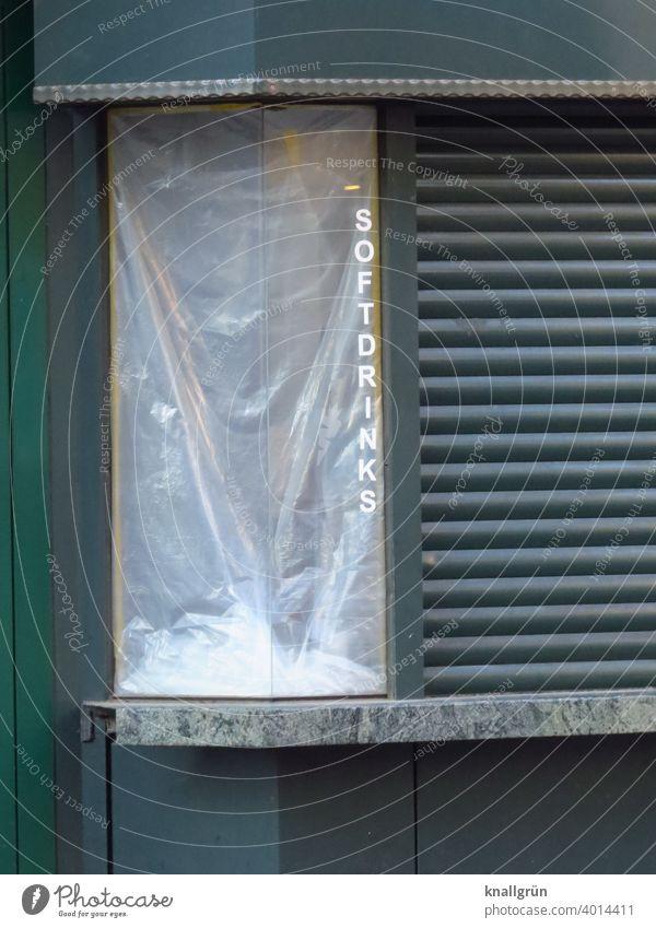 Soft drinks Sell Store premises Exterior shot Facade roller shutter Closed coronavirus pandemic lockdown broke Insolvency Crisis Trade business Shop window