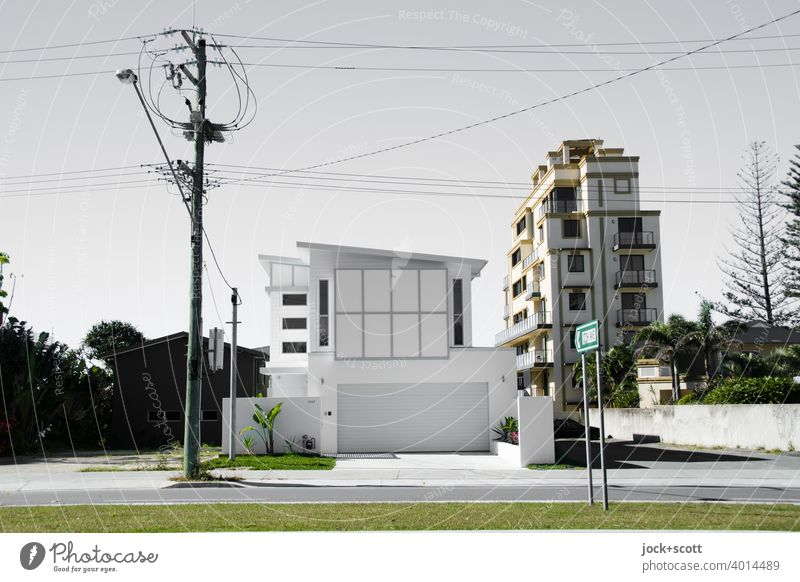 Luxurious villa with large garage Villa Modern architecture Luxury Street lighting Electricity pylon power line Tower block Facade Road marking Gold Coast