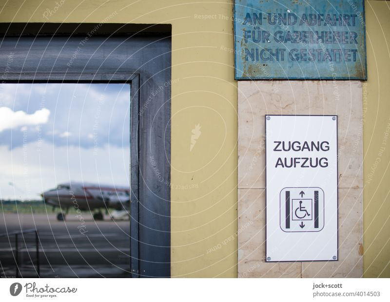 Elevator access from the tarmac Detail Reflection Airplane Vacation & Travel Sky Clouds Access Key Pictogram Wheelchair Tempelhof Airport Berlin Airfield