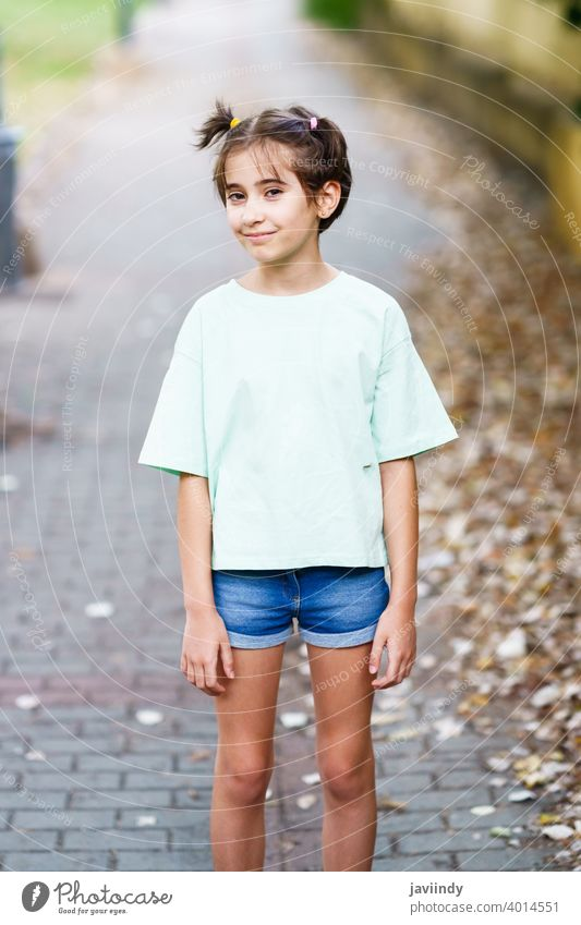 Nine-year-old girl standing in a city park female little child outdoor mockup cute lifestyle casual caucasian cheerful care single sitting beautiful leisure