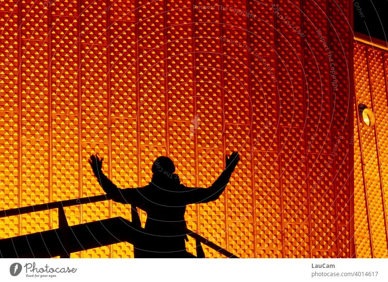 Shadow plays in front of the Berlin Philharmonic Hall philharmonic orchestra Night Evening Orange Gold silhouette luminescent Abstract structure Facade Sharoun