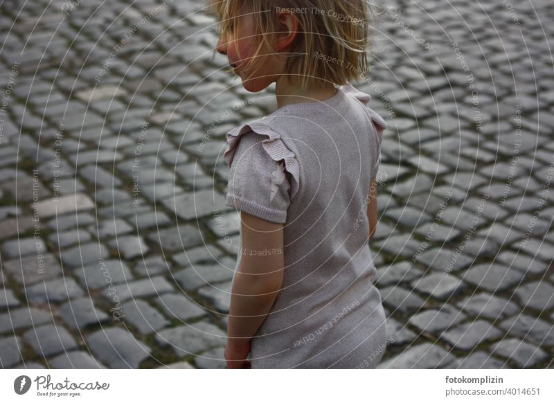 Child on a cobblestone path Paving stone Girl Playing Infancy portrait Exterior shot Small Cute youthful Parenting children Childlike Playground prohibition