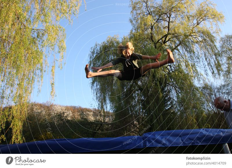Teen jumps on a trampoline Trampoline Hop Jumping power Gymnastics Acrobatic Fitness Joy Flexible Youth (Young adults) Movement Joie de vivre (Vitality) Sports