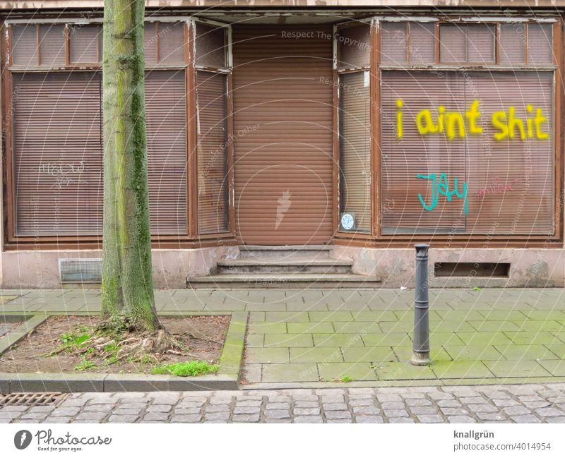 I aint shit House (Residential Structure) Graffiti Architecture Building Facade Exterior shot Town Deserted Day roller shutter Closed Derelict Old Window