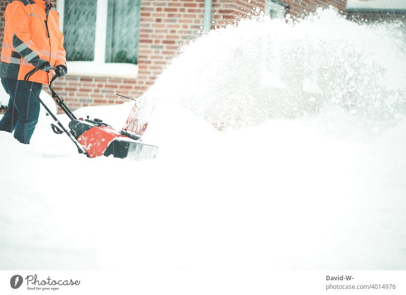 Man clearing snow aside with a snow blower in winter Snow masses a lot Winter maintenance program Storm warning Weather onset of winter off Snowfall White