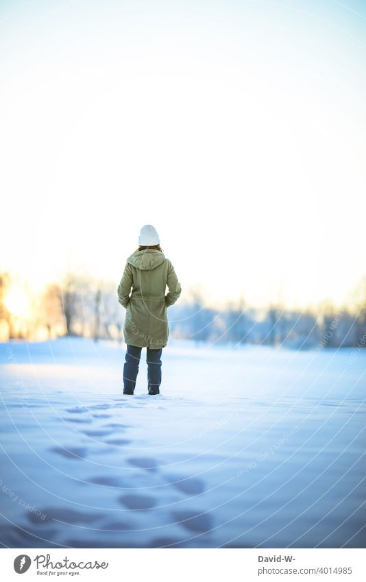 Woman takes a winter walk through the snow and enjoys the silence Winter walk Snow Nature Winter's day onset of winter chill Freeze tranquillity To enjoy