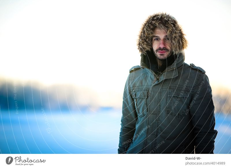 Man in winter with thick winter jacket Winter Cold chill onset of winter Winter's day Winter mood Snow Weather