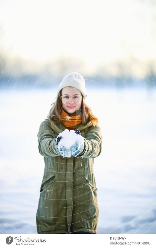 Woman holding snow in her hands and happy about winter Snow Joy stop Euphoria Winter Winter's day onset of winter Winter mood