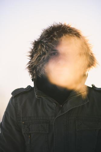 Man with thick winter jacket in cold winter weather Winter Freeze chill Breath Winter's day Winter mood Cold December