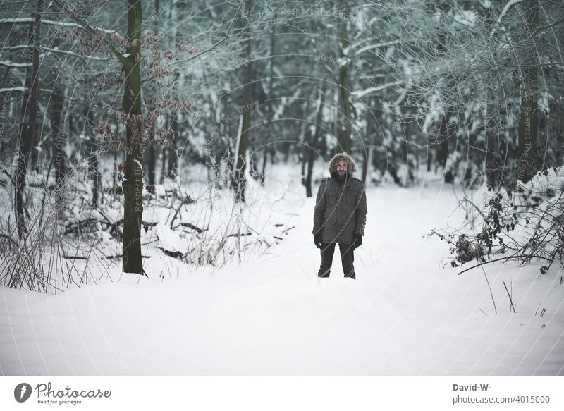 Man standing in icy cold in a snowy forest Forest Winter Cold Snow chill Winter mood Winter's day Hiking winter Winter forest Freeze December