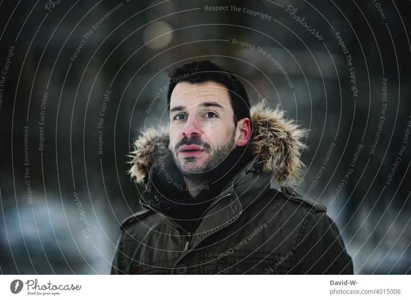 Man with warm jacket in cold weather in nature Cold Winter winter winter jacket chill Model Freeze Wintertime beginning of winter Dark Nature