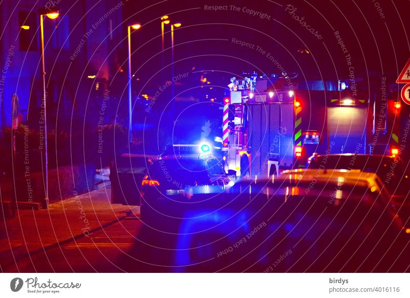 Nocturnal operation of the fire brigade Fire department Fire department deployment blue light Alarm Fire engine Night Residential area clearer
