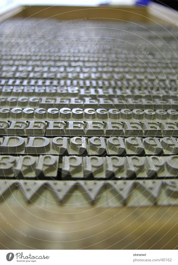 letters Typography Hot metal type Typesetter Letters (alphabet) Lead Media Newspaper Printing Sit Print shop Typecase Capital letter Craft (trade) Arrangement