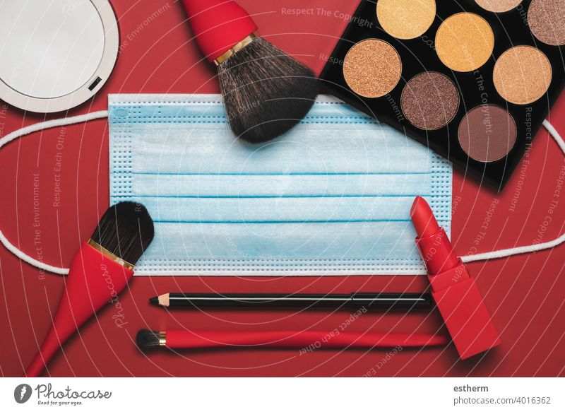 Flat lay of protective surgical mask with female cosmetics and accessories.Make Up Beauty Fashion Concept coronavirus coronavirus masks 2019-ncov covid 19