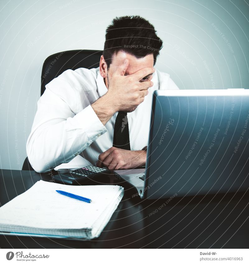 anxious businessman in front of laptop holds his hand in front of his face anxiously Man Notebook Fiasco shocked Fear Business home office Desk labour Office