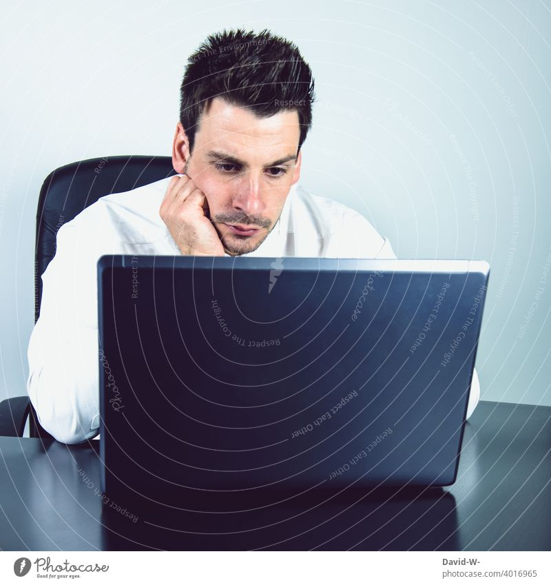 Man at laptop home office Earnest concentrated Computer work Online labour Workplace