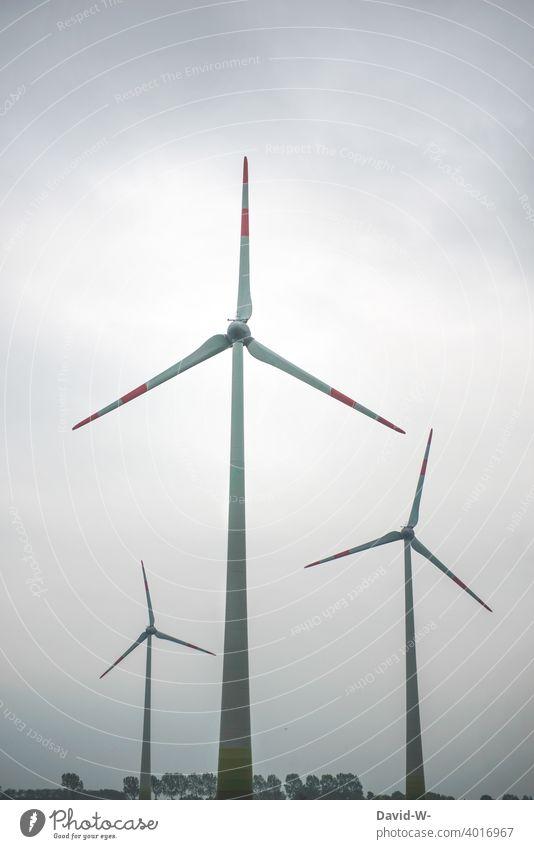 Wind energy - Wind turbines in nature windmills Pinwheel wind power Energy production Environment Wind energy plant Sustainability somber huge