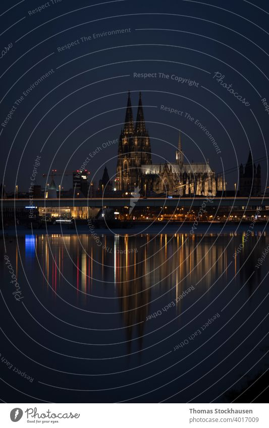 Cologne Cathedral by night, iluminated, reflection in the Rhine river architectural architecture attraction baroque blue building cathedral catholic catholicism