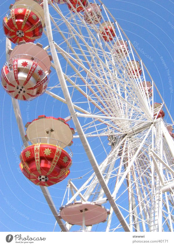 Under the wheel Ferris wheel Fairs & Carnivals Rotate Round Vantage point Romance Leisure and hobbies Joy Feasts & Celebrations Tall Sky Flying