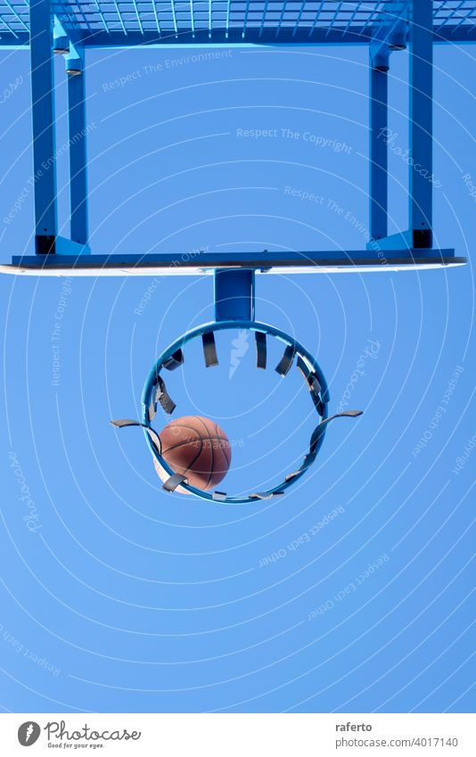 Basketball hit the net, the goal is achieved. Low angle view nobody hoop basketball score sport court equipment succeed scoring success shoot game play