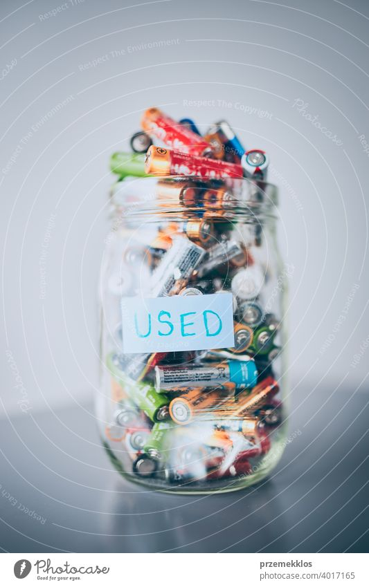 Jar filled with discharged used batteries. Waste disposal and recycling. Separating the waste battery bin collecting concept conceptual dispose ecological
