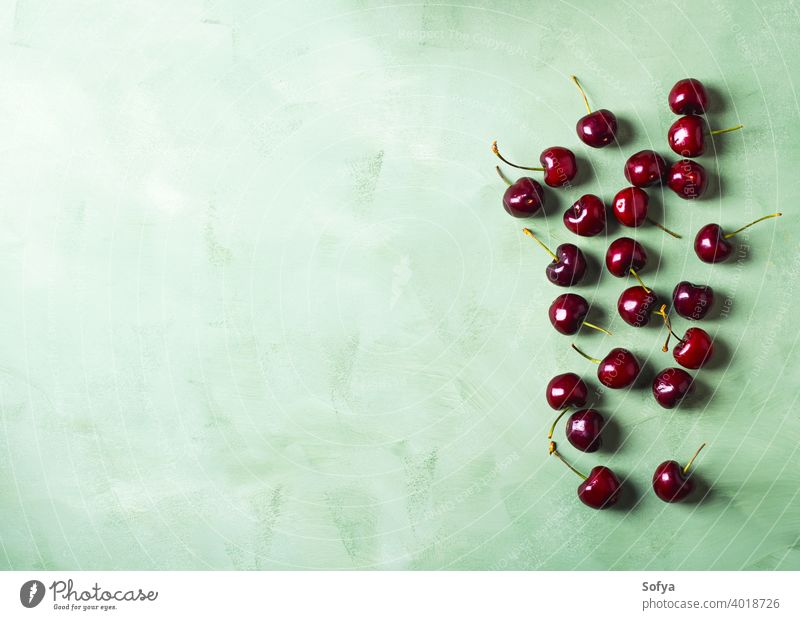 Fresh summer cherries berries on green background. Copy space cherry fruit red food organic wash top fresh kitchen clean leaf table sweet berry above ripe dark