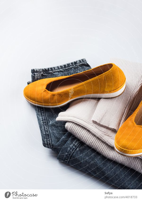 Fashion outfit jeans, yellow shoes, gray sweater fashion winter autumn clothes female casual apparel personal color cozy folded accessories woman style warm