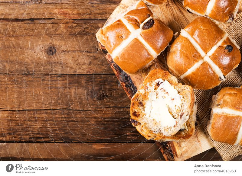 Easter Breakfast with Hot Cross Buns hot cross bun easter bread butter food traditional sweet fresh white holiday wooden celebration cake baked treat view