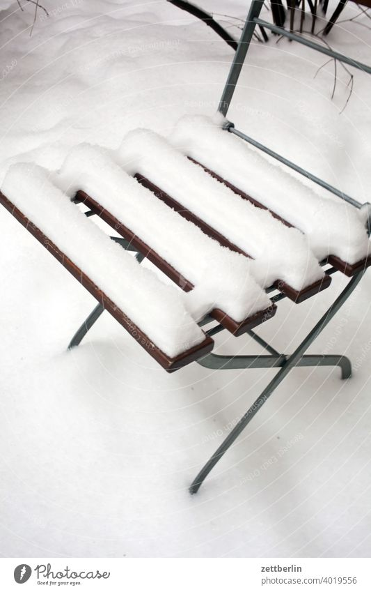 Garden chair in fresh snow Berlin Ice February holidays Frost jenuar Cold chill Virgin snow Snow Town urban Winter winter holidays January Chair Folding chair
