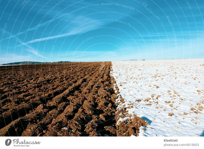 Blue - Brown - White - the colors of winter! Fallow field - ploughed field - deep blue winter sky with tender cloud stripes Winter sky brown field CROSSED