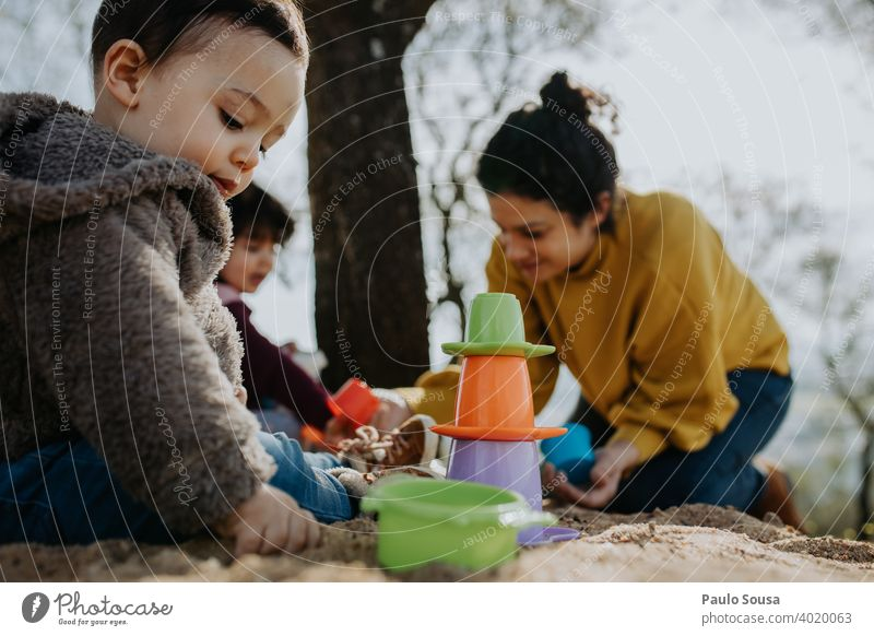 Child playing outdoors with sand Family & Relations Mother with child motherhood Parenting Playing Toddler 1 - 3 years Infancy Together Joy Love Happiness Life