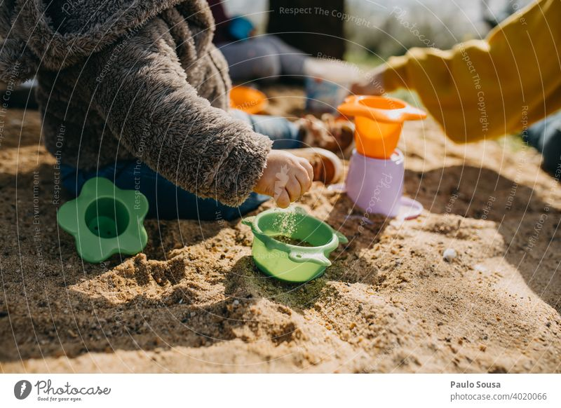 Child playing outdoors with sand childhood Playing Sand Toys Childhood memory Infancy Sandpit Kindergarten Joy Toddler Colour photo Children's game