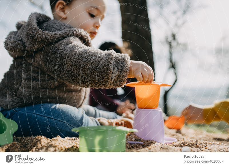 Child playing outdoors with sand childhood 1 - 3 years Authentic Spring Sand Infancy Colour photo Toddler Human being Lifestyle Playing Happiness