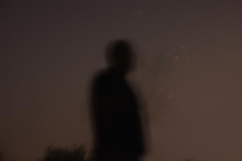 portrait of unfocused man watching stars with an dark sky in the background male person face poster bokeh people black night elegant concept soft focus fashion