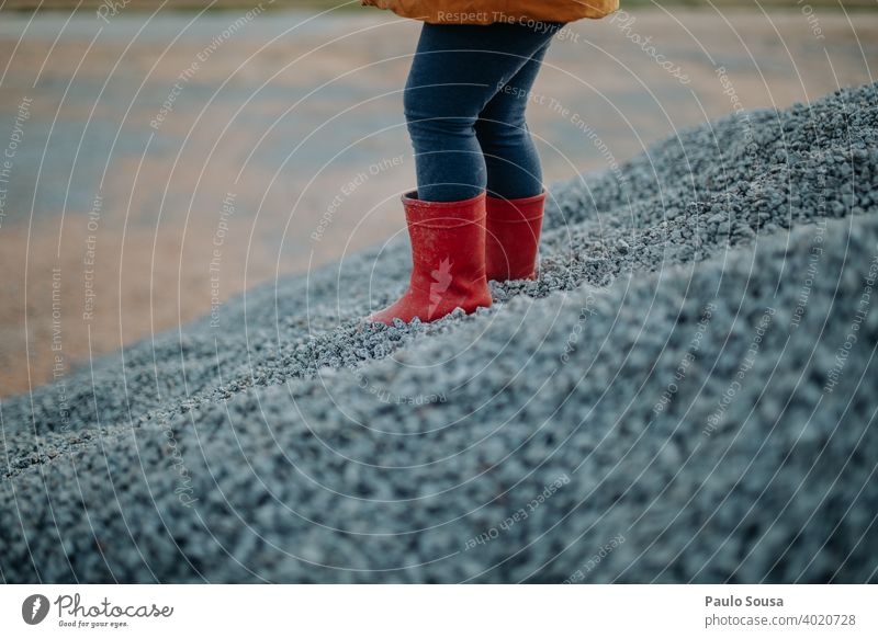 Child with red rubber boots Rubber boots childhood Red Footwear shoes Clothing Colour photo Exterior shot Weather Boots Rain Green Day Multicoloured Infancy