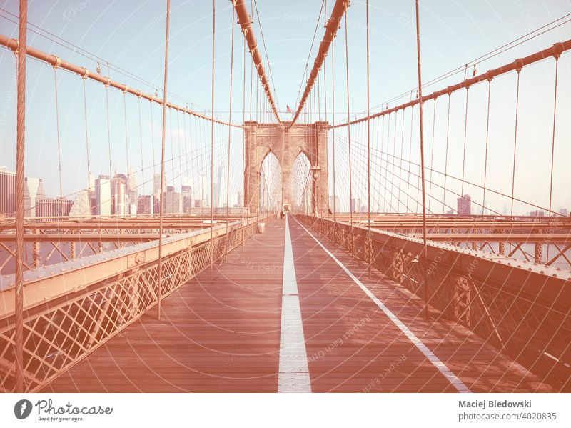 Retro color toned picture of Brooklyn Bridge, New York City, USA. city skyline cityscape retro vintage effect building filtered NYC urban travel bridge way path