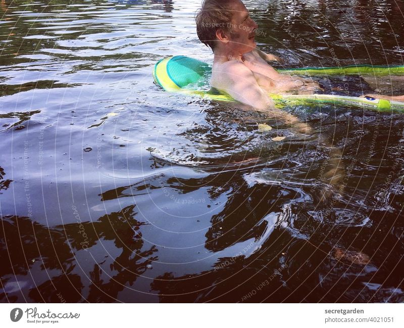 Left side of the water. Man Water Pond bathe Summer rubber boat Swimming & Bathing Lake cooling Wet Nature Human being Exterior shot Colour photo Day